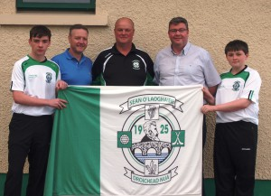 Pictured are Paul and Eamon Donnelly of Uform handing over a set of t-shirts for the U14 Feile team to Adrian McCann (Vice Chairman), also pictured are U14 players Luke and James Donnelly